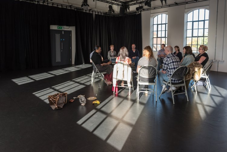 Photo: An artist conversation happening in one of Dance4's studios at their international centre for choreography. credit: Matthew Cawrey