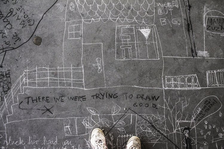 drawing on concrete floor with chalk and charcoal