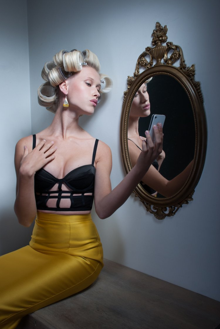 Editorial Model looking at herself in the mirror wearing Merci Me London