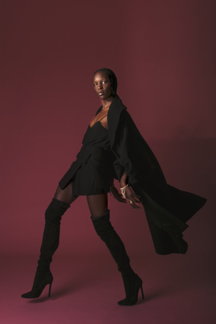 Lookbook Merci Me London Model wearing black coat with high heel boots