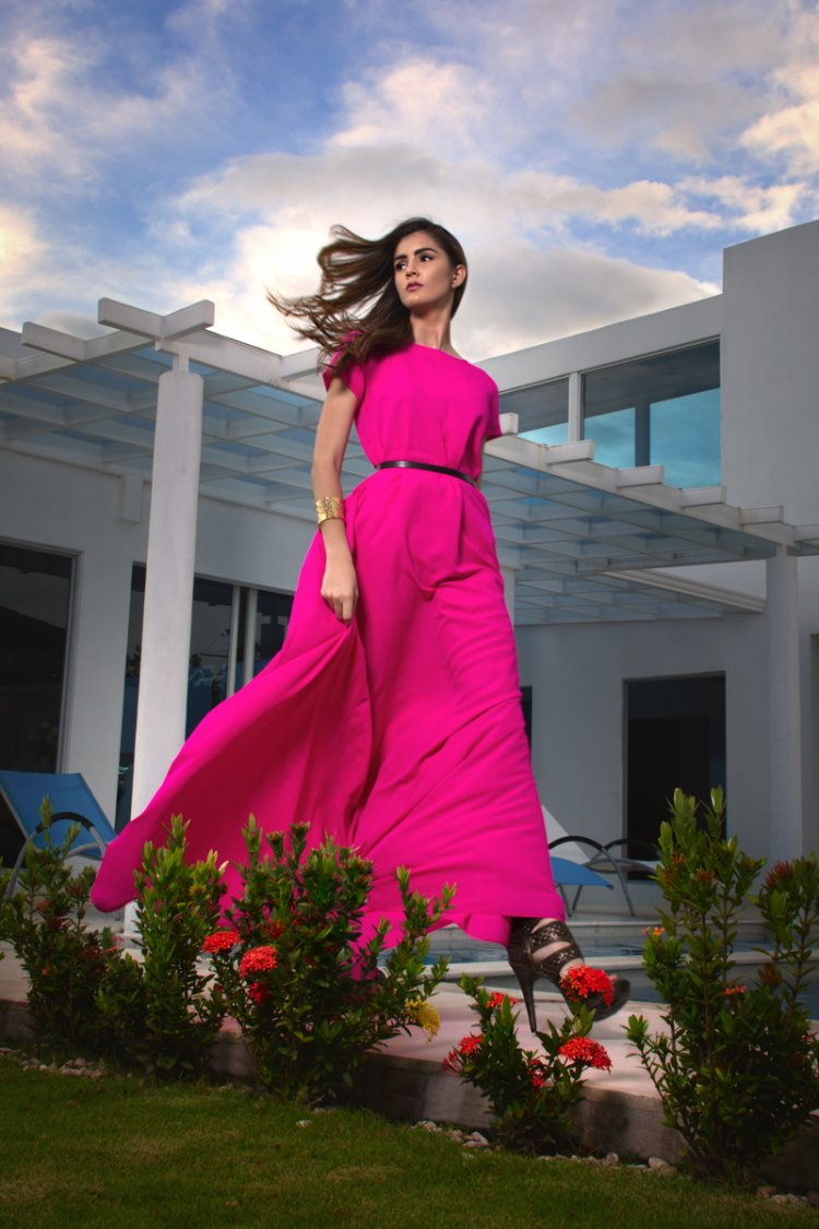 Lookbook Merci Me London Model wearing pink dress at beach house